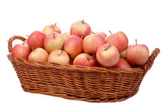 Apples in the basket. On a white background royalty free stock photos
