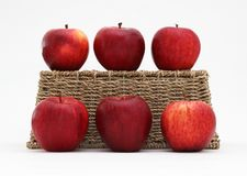 Apples and a basket Royalty Free Stock Photo