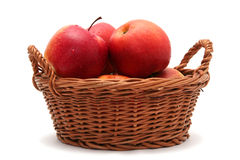 Apples in basket. Red fresh apples in basket on a white background Royalty Free Stock Image