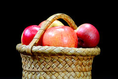 Apples in the basket on a black Stock Photo