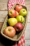 Apples in a basket case Stock Images