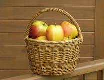 Apples in basket closeup Stock Photos