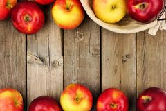 Apples with basket, double border on rustic aged wood Royalty Free Stock Photography