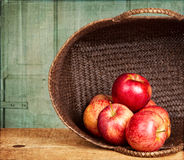 Apples in basket on grunge background Stock Photography