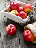 Apples in basket. On old grey wood table Stock Images