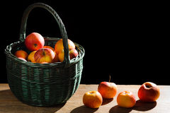 Apples in basket on old plank Royalty Free Stock Image