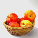 Apples in the basket. Organic apples in the wicker basket on white background Stock Photography