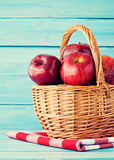 Apples in a basket over turquoise wood Royalty Free Stock Photo