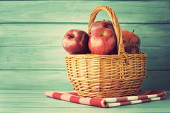 Apples in a basket over turquoise wood Royalty Free Stock Photos