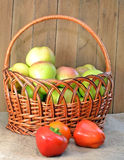 Apples in basket and pepper Royalty Free Stock Photos