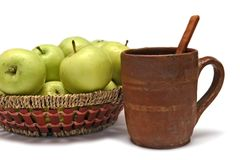 Apples in basket and potter mug Stock Photo