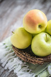 Apples in a basket on rustic background Royalty Free Stock Image
