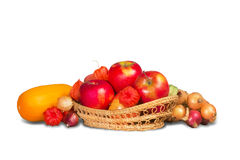 Apples in basket and vegetables Stock Photo