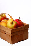 Apples in a basket on a white background Royalty Free Stock Photo