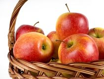 Apples in the basket. On the white background Royalty Free Stock Photo