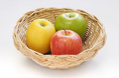 Apples in basket white background. Apples in a woven basket on white background Royalty Free Stock Photo