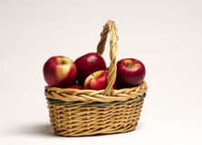 Apples basket Stock Photos