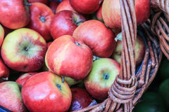 Apples in a basket. Apples in a wicker basket. Selective focus Stock Photo