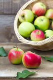 Apples. In a basket on a wooden table Royalty Free Stock Photos