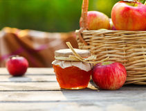 Apples in a basket on wooden table Stock Photography