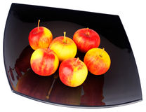 Apples on black plate Royalty Free Stock Photo