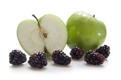 Apples and blackberries Stock Photos