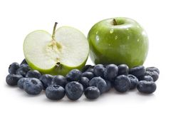 Apples and blueberries stock photos