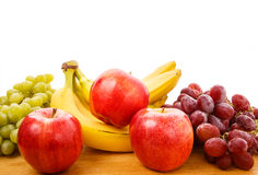 Apples Bnanas and Grapes on Table Royalty Free Stock Photo