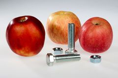 Apples and bolts Royalty Free Stock Photography