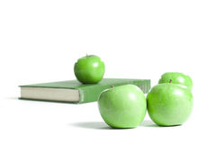Apples on a Book Stock Photography