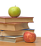 Apples and books Stock Images