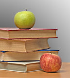Apples and books Royalty Free Stock Photo