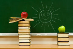 Apples on books Stock Photography