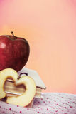 An apples and books on the fabric Stock Images