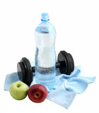 Apples, a bottle of clean water and dumbbell Stock Photo