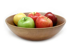 Apples in a Bowl. Colorful apple assortment in a wooden bowl isolated on white stock photos