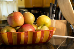 Apples in a bowl on counter Royalty Free Stock Photography