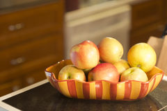 Apples in a bowl on counter Royalty Free Stock Photo