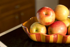 Apples in a bowl on counter Stock Photo