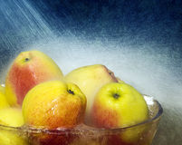 Apples in bowl with rain drops Royalty Free Stock Image