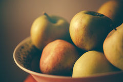 Apples in a bowl, retro toned Royalty Free Stock Photo