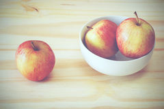 Apples. In a bowl on a wooden table Stock Photos