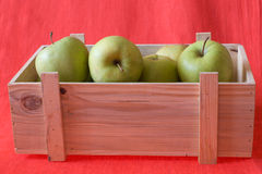 Apples in the box Stock Photos