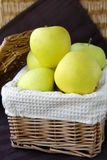 Apples in a box. Yellow apples in a wicker basket on the table stock photography