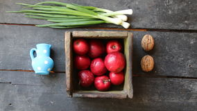 Apples in a box and Fresh Spring Onions on the farmers market. stock video