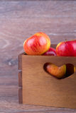 Apple in a box Royalty Free Stock Photography