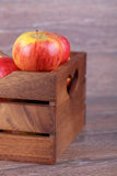 Apple in a box Stock Photography