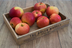 Apples in box. On wooden table Royalty Free Stock Photos