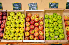 Apples in boxes. Fresh recently harvested green and red apples in wood boxes Royalty Free Stock Photography