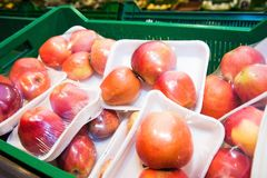 Apples on boxes in supermarket Royalty Free Stock Images